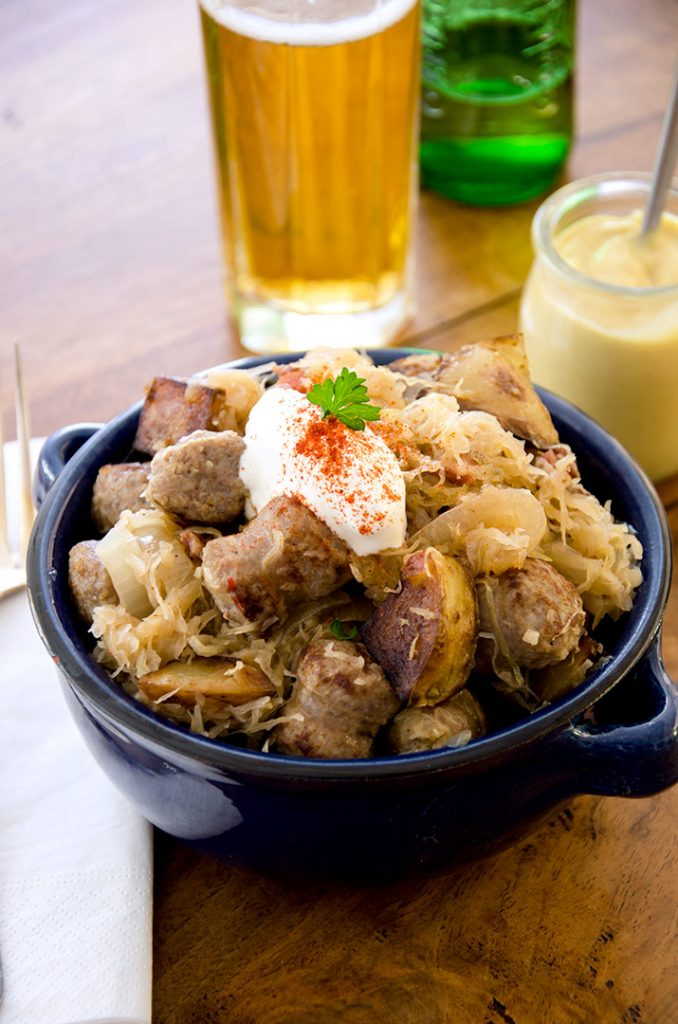 Sausage and sauerkraut with a cold beer. Perfect on a cold winter day.