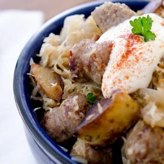 The best way to eat sausage and sauerkraut is with a dollop of sour cream and some mustard. It's just so tasty!