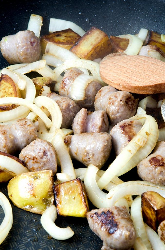 A good sausage and sauerkraut recipe adds in onions and other ingredients to enhance the flavors.