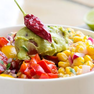 This southwestern salad is a big hit with guacamole, salsa, peppers, onions, a corn relish and chipotle salad dressing.