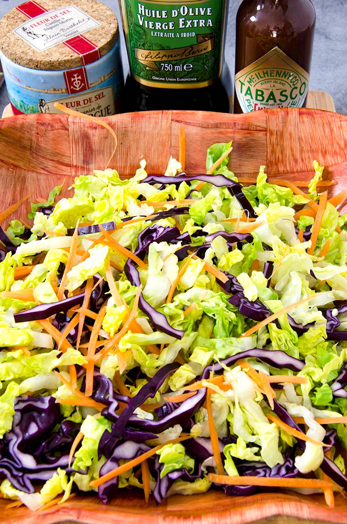 Using a Mexican style slaw provides a sturdy base to the southwestern salad's many toppings. Plus it tastes so good!