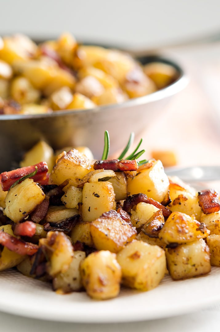 Mmm... I love homemade hash browns. Just a little bacon, fresh herbs and crispy cubed potatoes make it delicious!