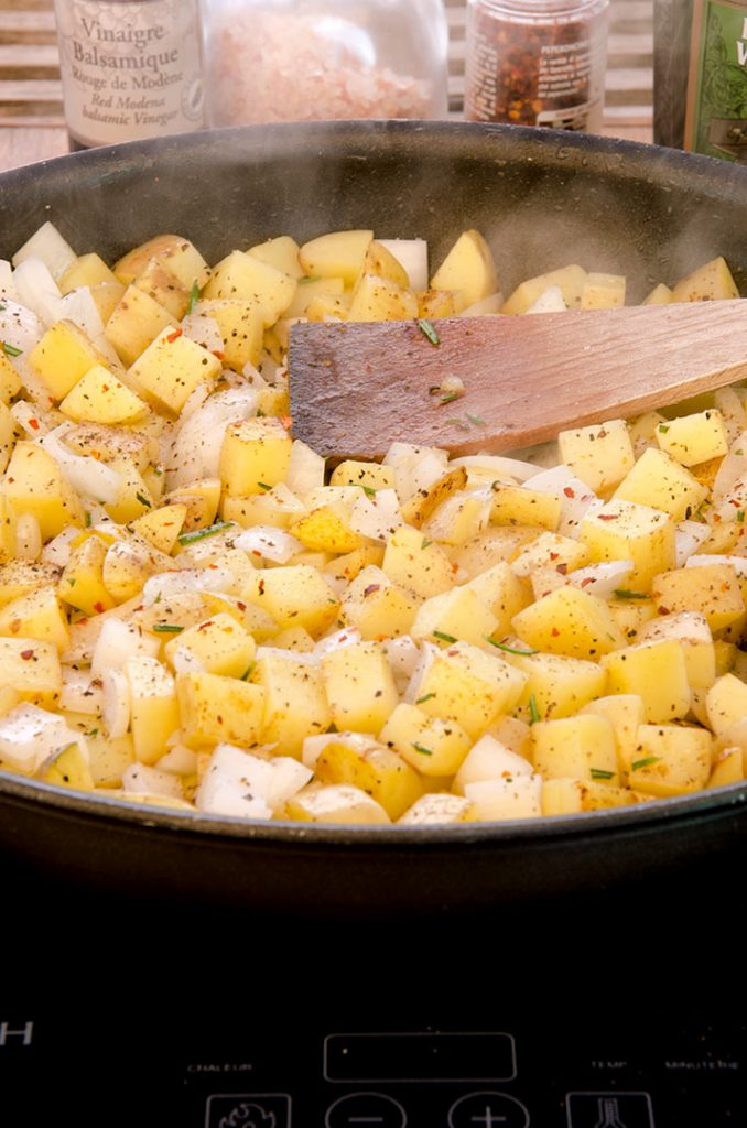 These delightful homemade hash browns are made in several steps, starting by browning the cubed potatoes over high heat.