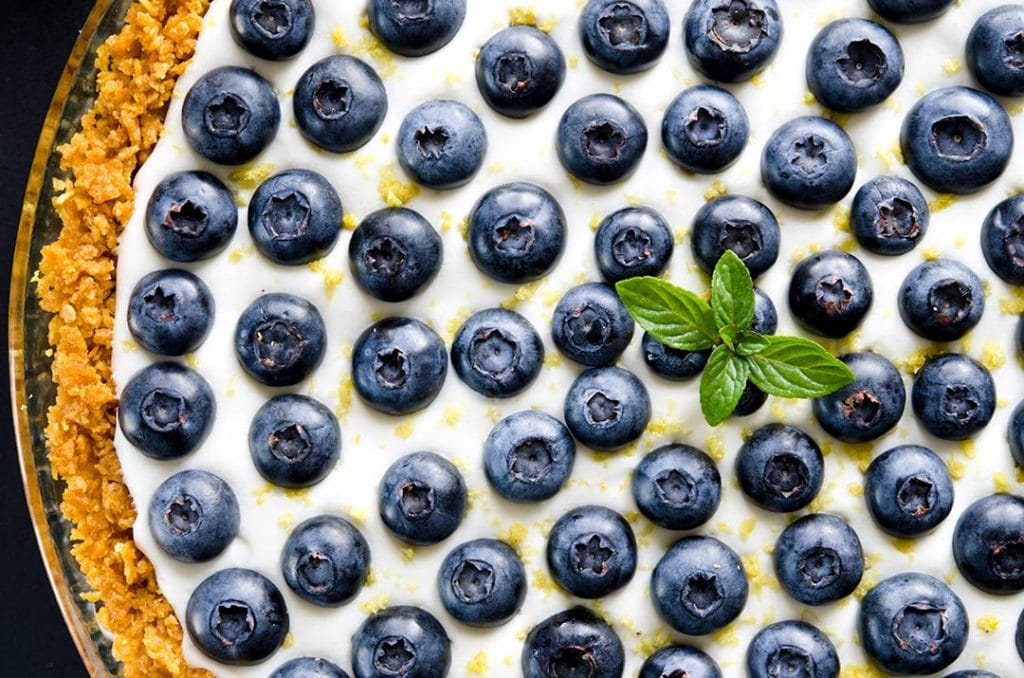 A light, fluffy no bake cheesecake with lemon, blueberries and gluten free crust.