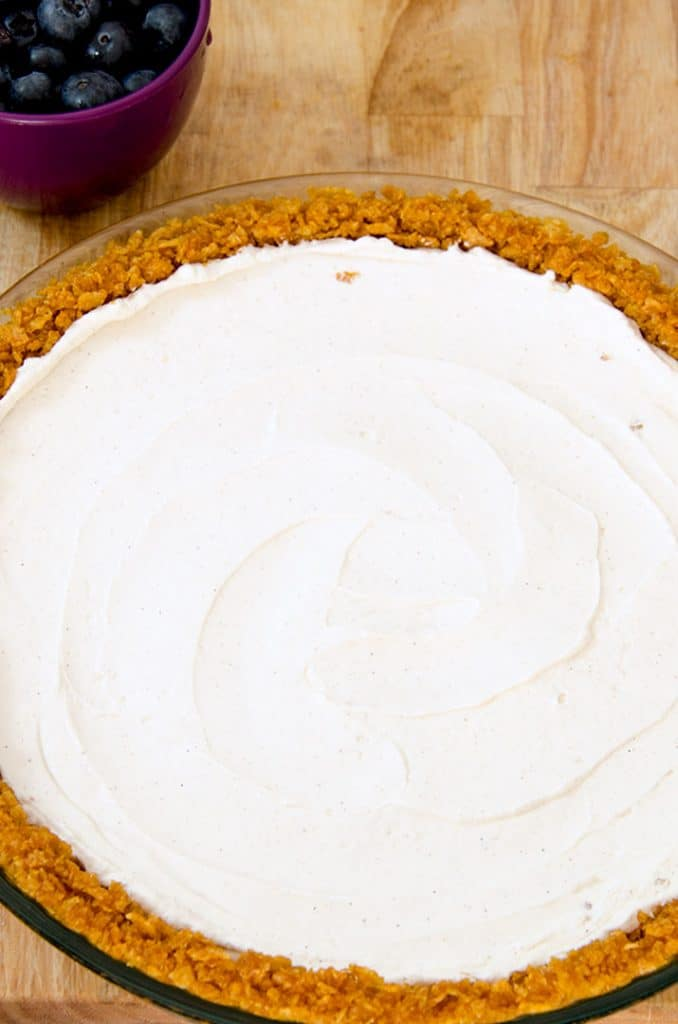 This no bake cheesecake starts with a gluten free pie crust and whipped cheesecake filling.