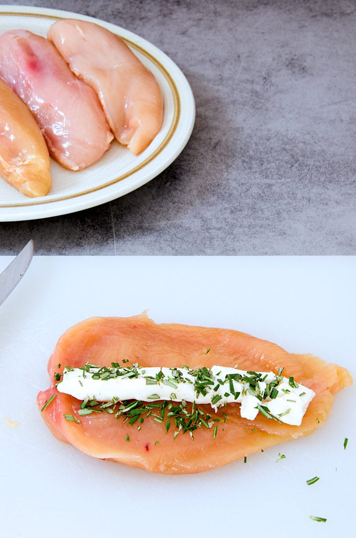 This stuffed chicken breast recipe starts with rosemary, chicken and goat cheese.