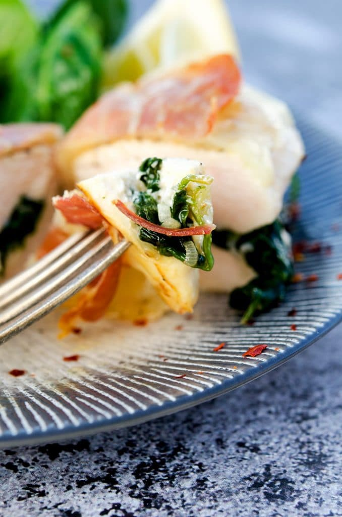 The combination of spinach, garlic, shallot and red pepper flakes make the perfect stuffing for this chicken saltimbocca.