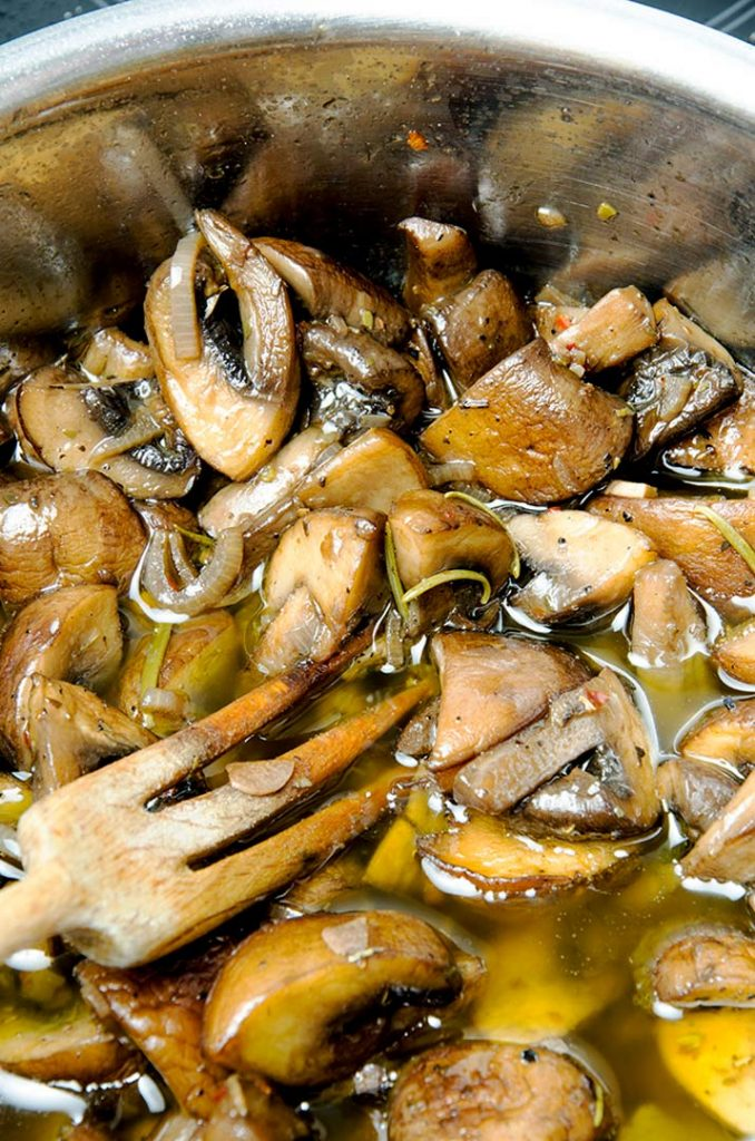 Marinated mushrooms cook for about 10 minutes, then cool in the pot to soak up all the delicious flavors.