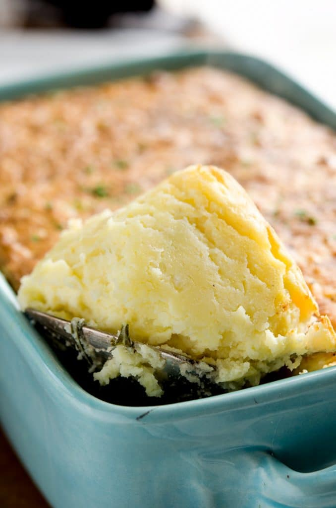 This mashed potato recipe is fluffy, light, golden and delicious. It is the absolute perfect side dish for any sit down meal!