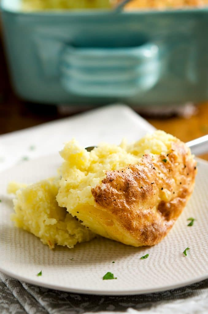 A delightful sight at any meal... this mashed potato recipe is golden, light, fluffy and has a delicious crunchy crust.