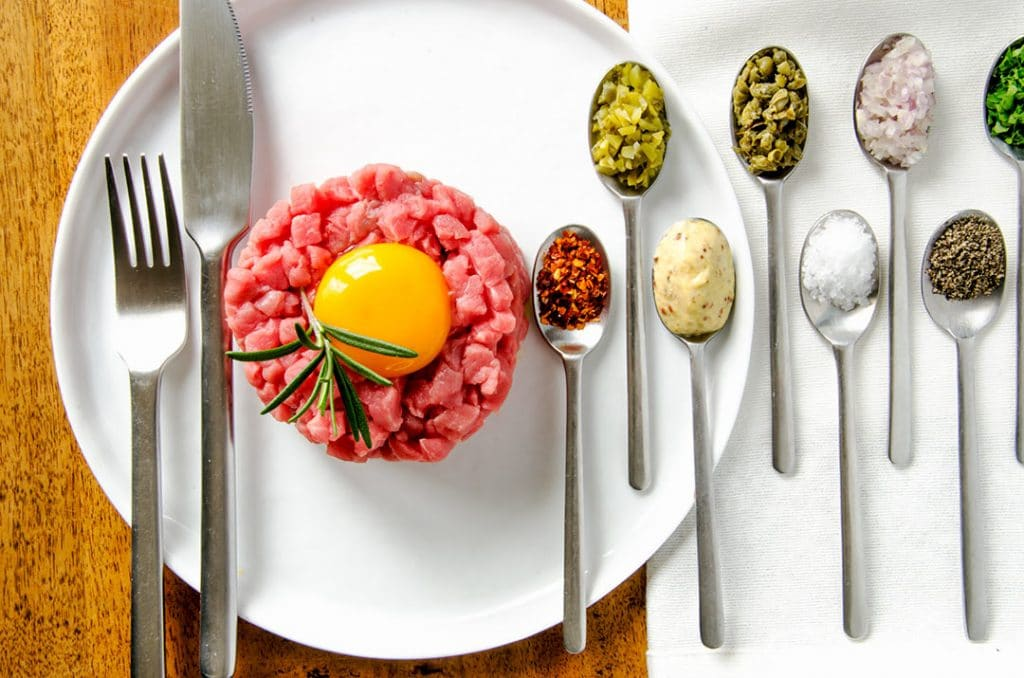 Steak tartare loves seasoning with mustard, capers, cornichon, salt, pepper, shallots, parsley and hot pepper flakes.