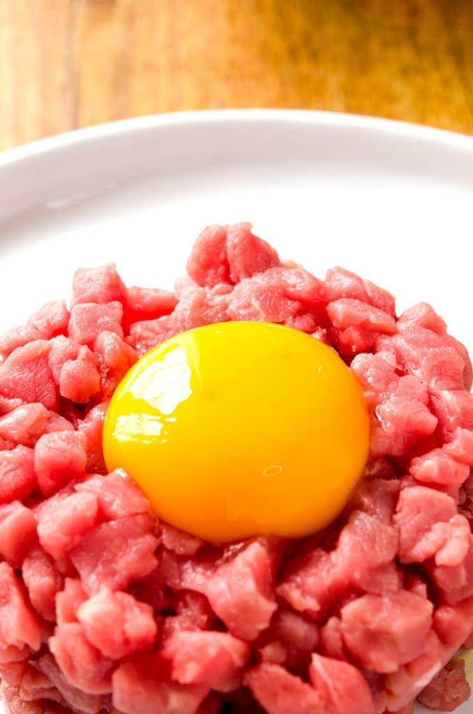 Steak tartare should be made with a raw egg and lots of flavorful toppings!
