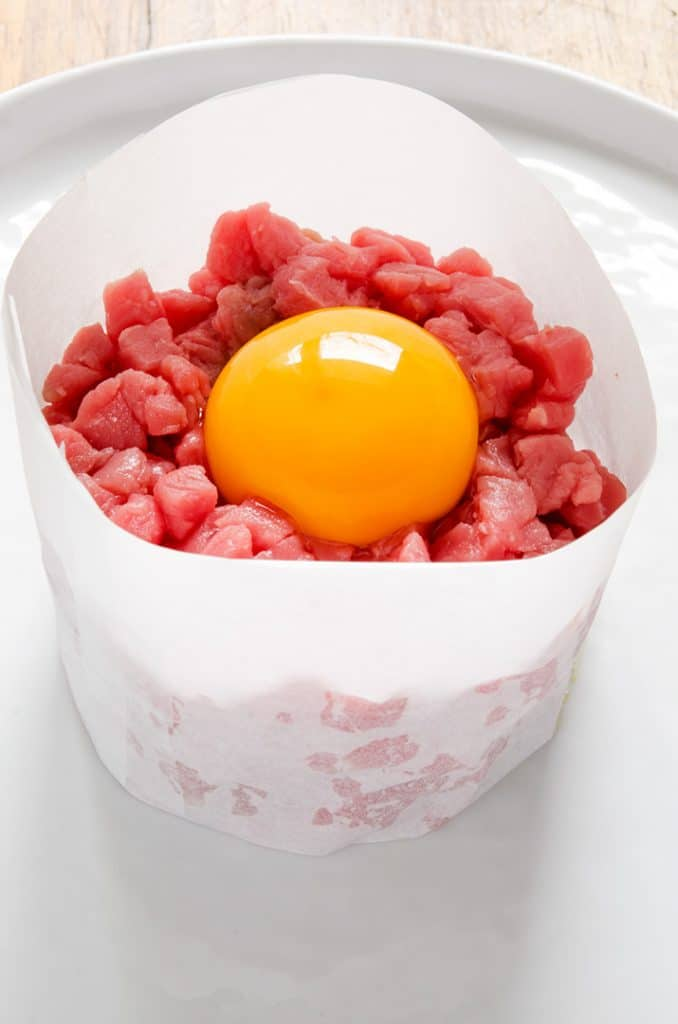 Presentation is important with a steak tartare recipe. Use a paper ring mould if you don't have a metal one.