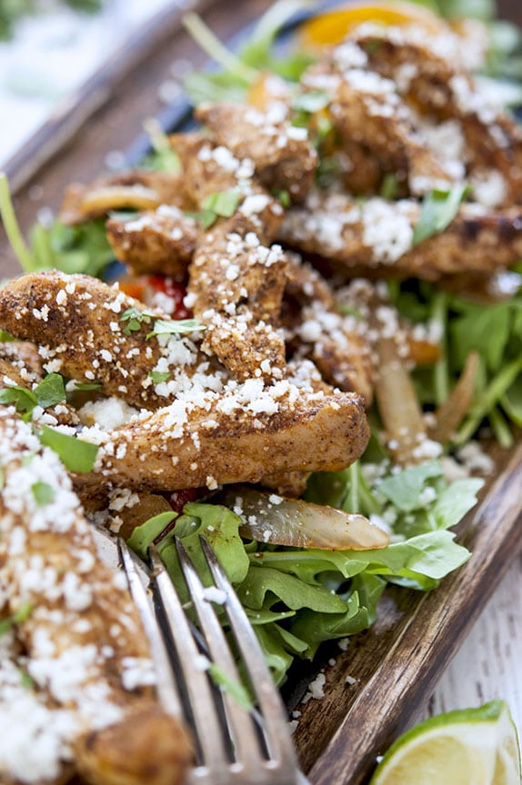 Topped with fresh cilantro and a dusting of crumbly cotija cheese, these oven baked chicken tenders are LOW CARB and GLUTEN FREE too!